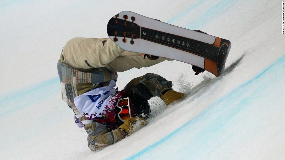 Danny Davis of the United States falls during his first run in the halfpipe finals on February 11.