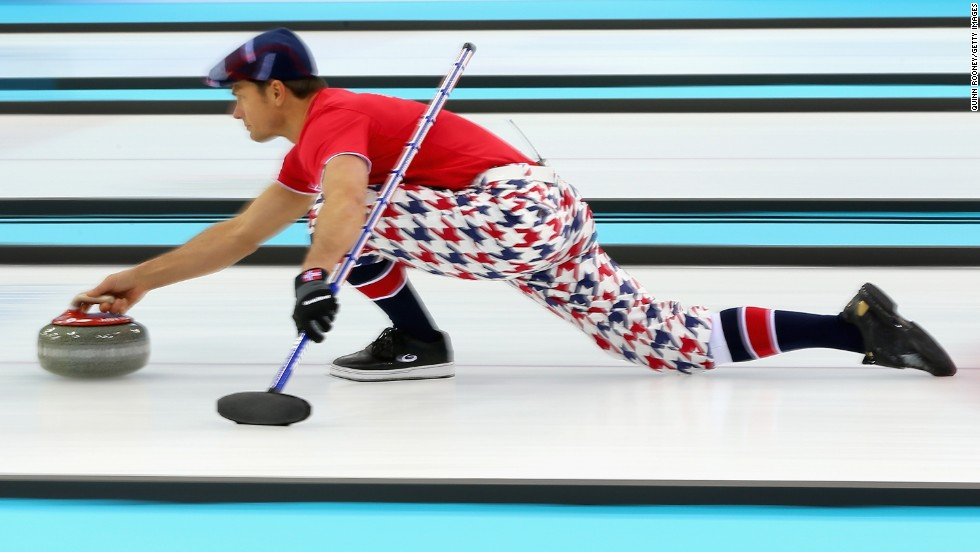 Thomas Ulsrud of Norway slides with the curling stone during a match against Germany on February 12.