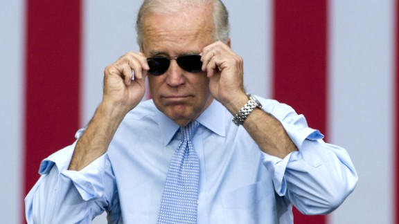 Vice President Joe Biden takes his sunglasses off as he arrives for a campaign event with President Barack Obama in Portsmouth, New Hampshire on September 7, 2012.