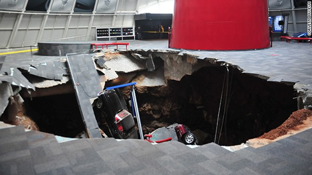 We received a call at 5:44am from our security company alerting us of our motion detectors going off in our Skydome area of the Museum.  Upon arrival it was discovered that a sinkhole had collapsed within the Museum.  No one was in or around the Museum at the time.  The Bowling Green Fire Department arrived on the scene and secured the area.  The Fire Department has estimated the size of the hole is 40 feet across and 25-30 feet deep.