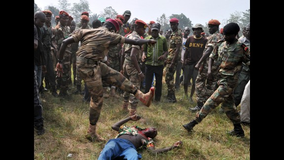 Members of the Central African Armed Forces lynch a man suspected of being a former Seleka rebel Wednesday, February 5, in Bangui.