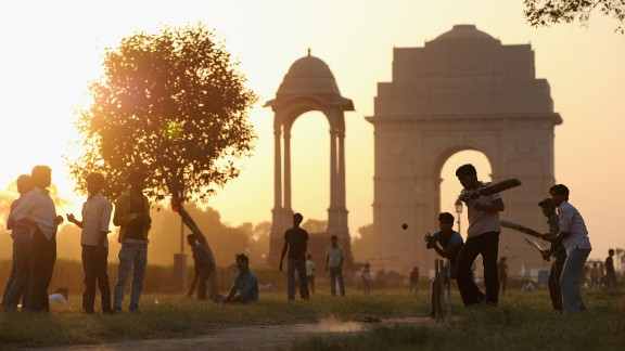 Cricket is most popular sport in India, widely played in schools, local parks and even streets. Here, local children play cricket in India Gate Park in Delhi.