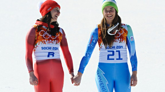 Alpine skiing's 2013 World Cup champion Tina Maze, right, made history at Sochi when she shared the women's downhill gold with Switzerland's Dominique Gisin. The Slovenian then won the giant slalom to become only the second woman to triumph in both events.