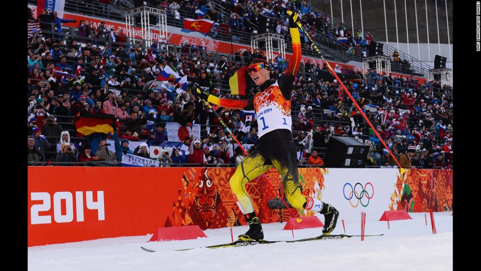 Eric Frenzel of Germany celebrates after winning the gold medal in the men's Nordic combined normal hill event on February 12.