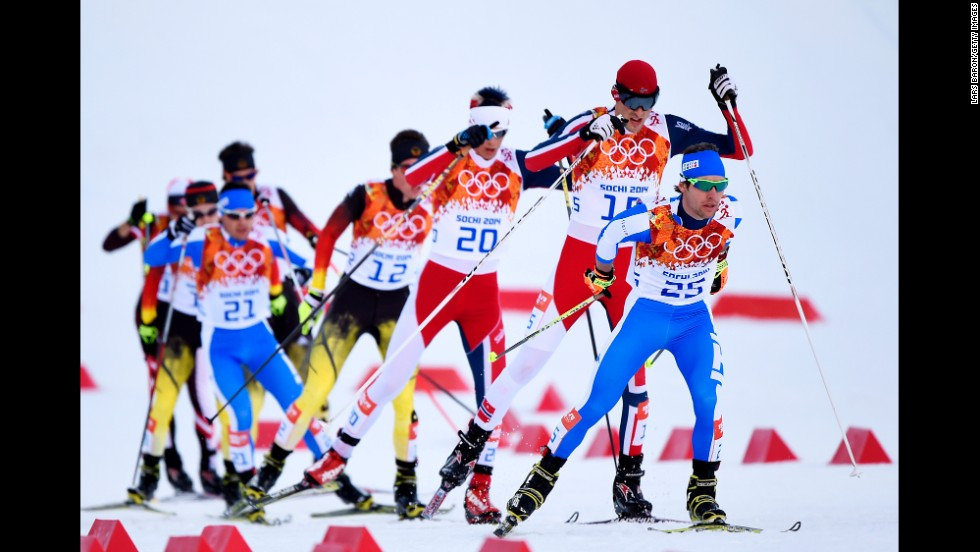 Alessandro Pittin of Italy leads a group of skiers during the cross-country portion of the men's Nordic combined event February 12.