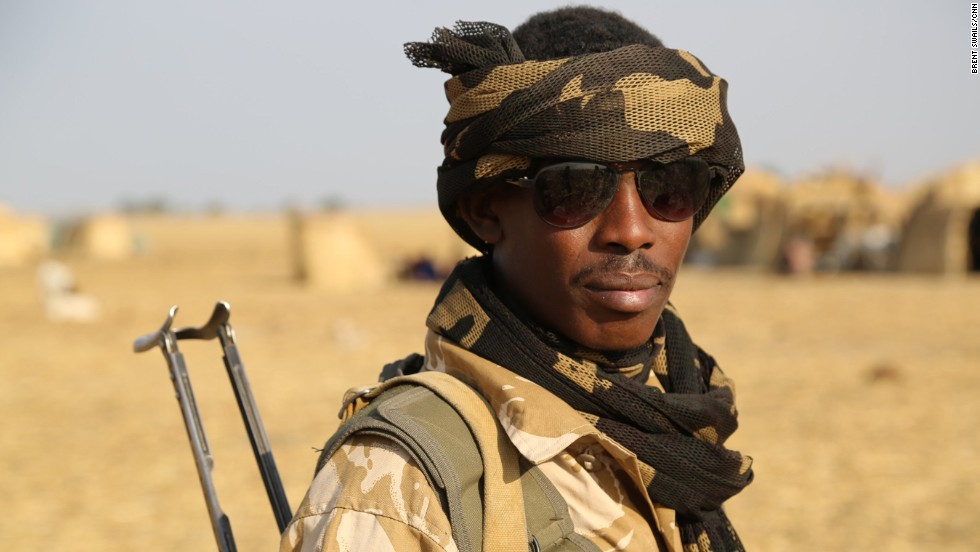 A member of Zakouma's newly formed rapid response team patrols the plains surrounding the park's border. The team was formed by park management to take on an increasingly militarized poaching threat.