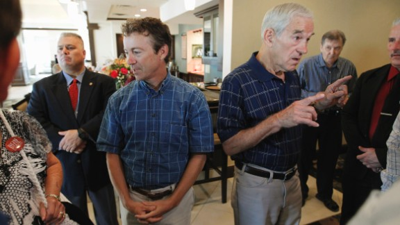 Paul and his father speak with supporters in Ames, Iowa, before the start of a 2012 presidential campaign event.