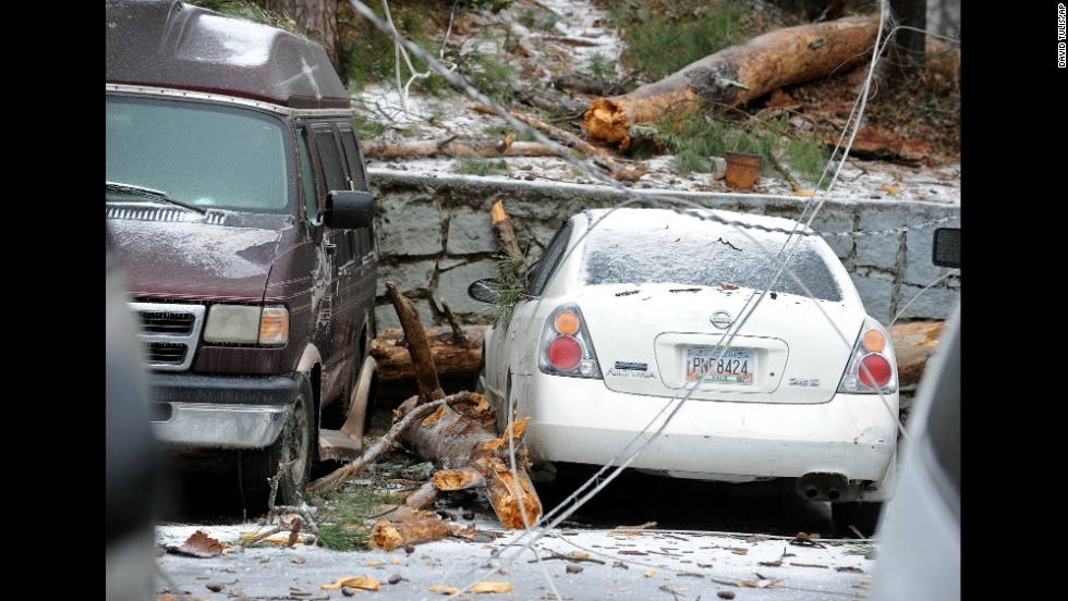 A downed power line is draped across several vehicles in Atlanta on February 12.