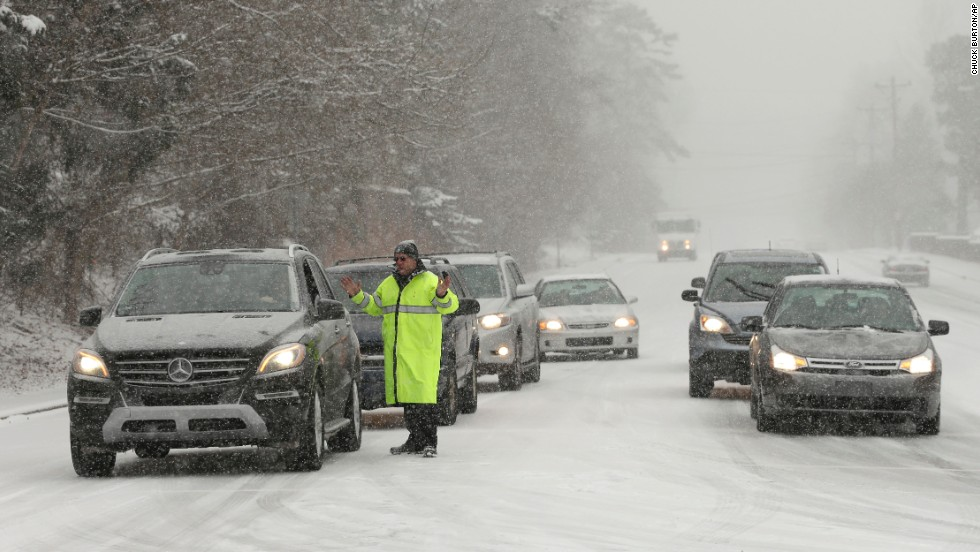 A police officer redirects traffic in Charlotte, North Carolina, on February 12.
