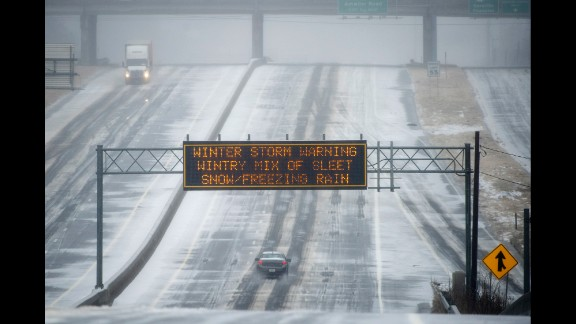 A sign warns drivers of winter weather as they travel on a bleak section of Highway 141 in Norcross, Georgia, on February 12.