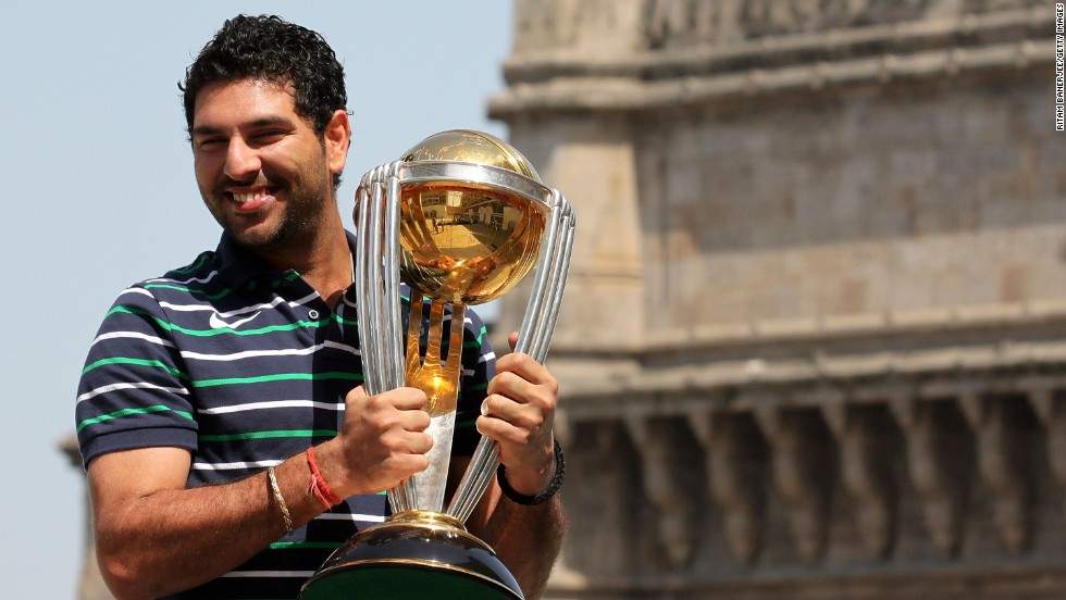 Yuvraj Singh, of the Indian national team, poses with ICC Cricket World Cup Trophy. Singh is one of the sport's highest paid players. The Royal Challengers Bangalore made a successful bid for him at $2.33 million during the IPL players auction.