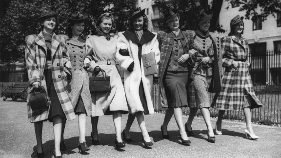 These American models from 1940 know how to dress to impress. But how has women's work wear evolved over the last century? And who were some of the pioneering power dressers who helped shape it?