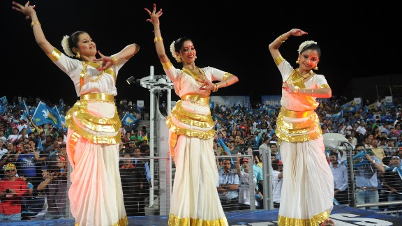 Some aspects of the Indian cricket league remain traditional. Here, Pune Warriors cheerleaders dance before the start of a match between the Warriors and Chennai Super Kings.