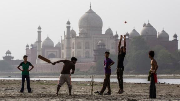 Boys play cricket on the banks of the Yamuna river near Taj Mahal. Cricket is India