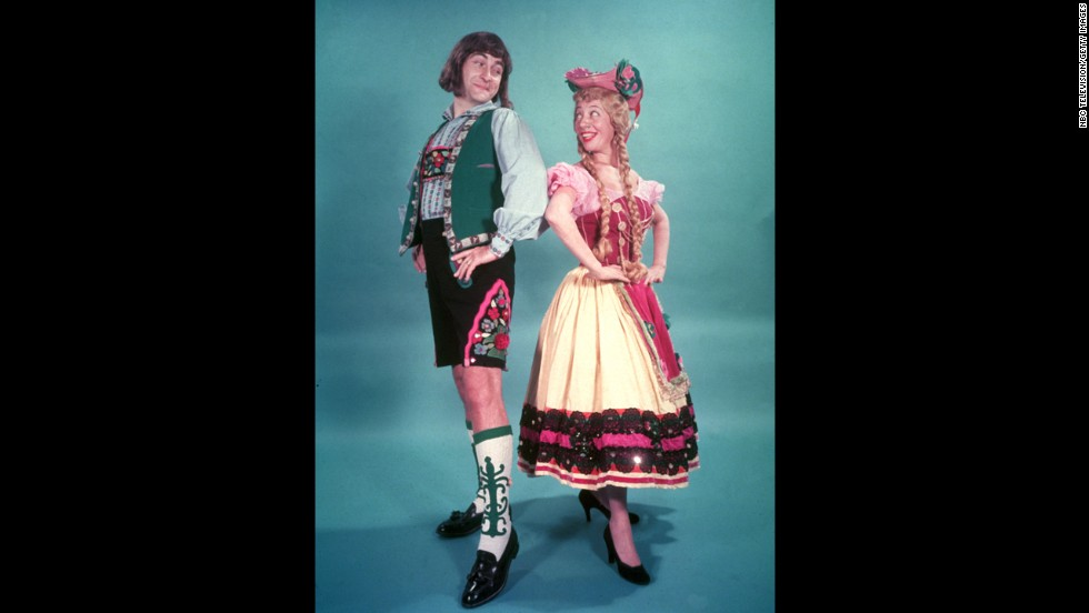 "Caesar and Imogene Coca wear Bavarian costumes during a promotional photo shoot for the 1950s television program ""Your Show of Shows."""