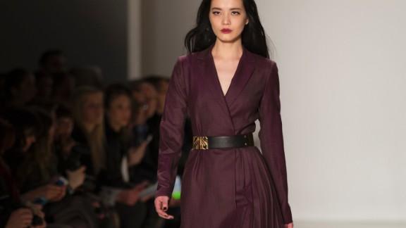 Nanette Lepore kept maroon suiting feminine with a tiger print belt.