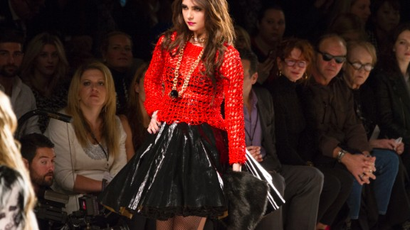 Betsey Johnson played with texture by lining a black skirt with tulle and crocheting a red mesh top.