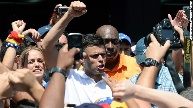 Opposition leader Leopoldo Lopez (C) greets supporters during an opposition demo against the government of Venezuelan President Nicolas Maduro, in Caracas on February 12, 2014. Unidentified assailants on a motorcycle fired into a crowd of anti-government protesters, leaving at least two people wounded and a pro-government man dead. AFP PHOTO / JUAN BARRETO (Photo credit should read JUAN BARRETO/AFP/Getty Images)
