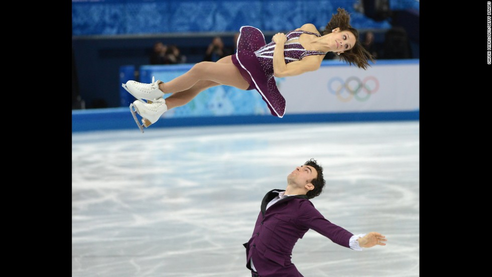 Canada's Meagan Duhamel and Eric Radford compete in pairs figure skating on Wednesday, February 12.