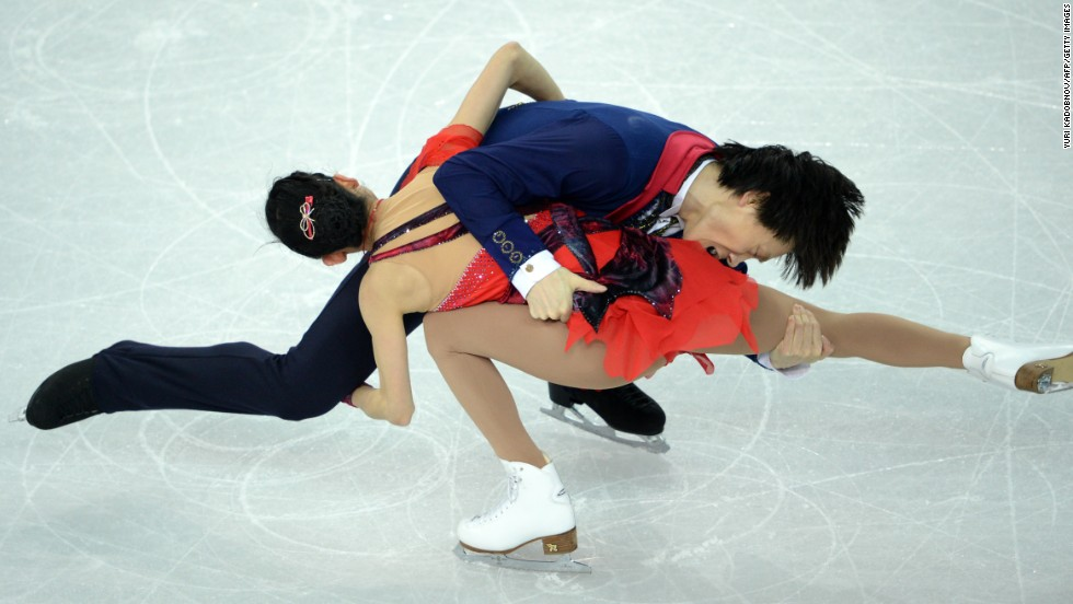 China's Qing Pang and Tong Jian perform their free skate routine during pairs figure skating on February 12.
