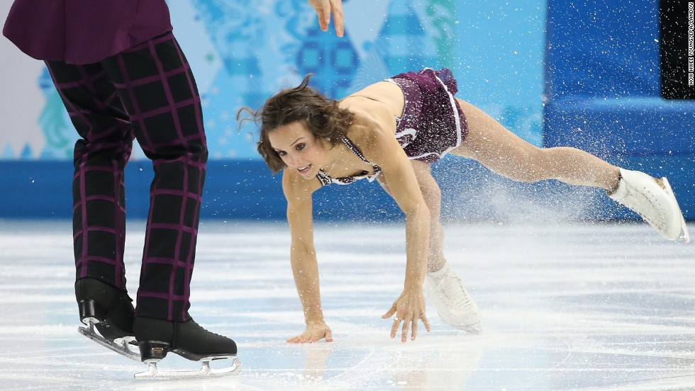 Canada's Meagan Duhamel falls during her free skating routine with Eric Radford on Wednesday, February 12.