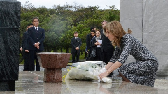U.S. Ambassador to Japan Caroline Kennedy places a bouquet of flowers at a cemetery of war dead killed in the World War II at the Peace Memorial Park in Itiman, Okinawa prefecture on February 12, 2014.
