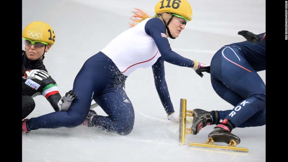 From left, Italy's Arianna Fontana, Great Britain's Elise Christie and South Korea's Park Seung-Hi fall as they compete in the 500-meter short track speedskating final on February 13.