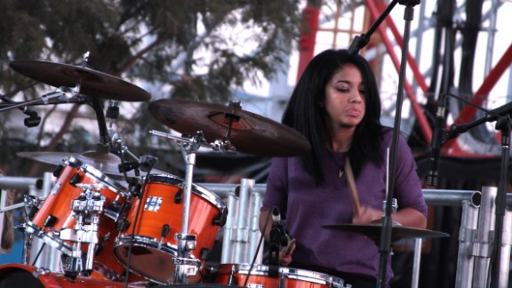 "Skinflint's new drummer, Alessandra Sbrana, is a rare female musician in Botswana's rock scene. One female rock fan, Katie, told CNN: ""I just enjoy it. It's a happy feeling. If you knew my brothers and sisters, it's something that we are as a family."