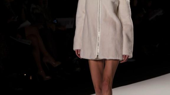 A bare-legged model rocked a cozy coat down the runway.