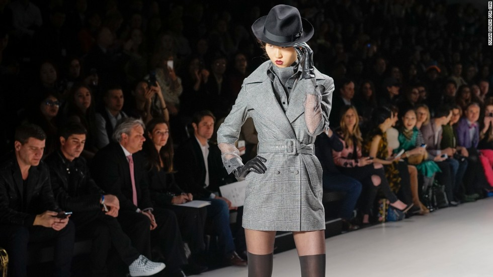 Malaysian-born designer Zang Toi showed his fall collection on February 12. He opened up the show with a series of tailored, gray plaid pieces.