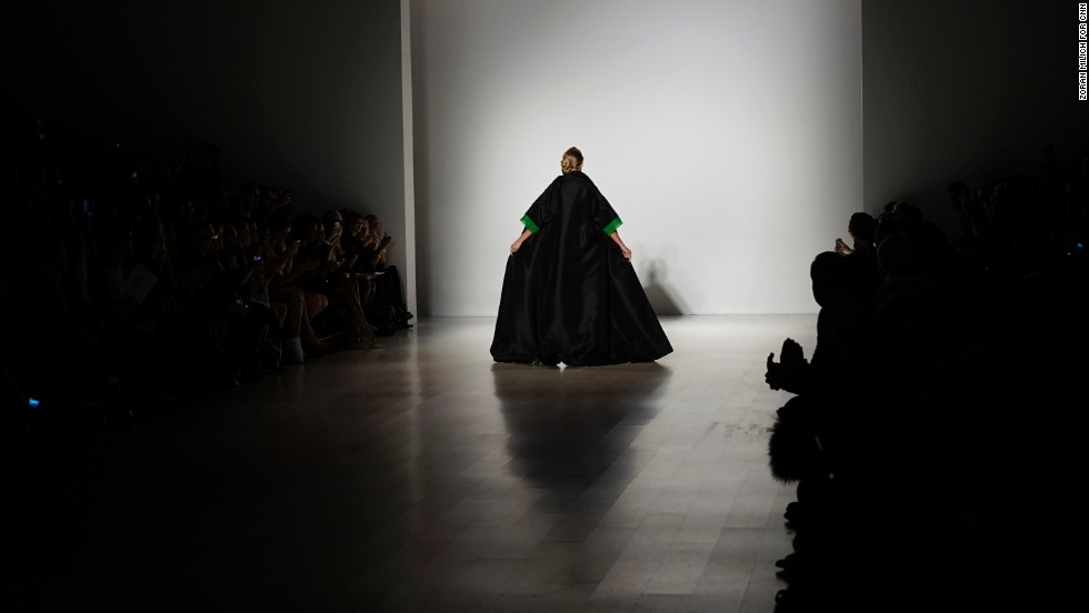 For a flashy finish, Zang Toi paired a sleek, black silk gown with a Kelly green-lined, full-length cape coat.