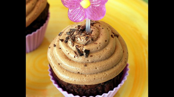 Vitamin- and fiber-rich canned pumpkin, which offers protection against heart disease, serves as an excellent substitute for butter or oil in these cupcakes.