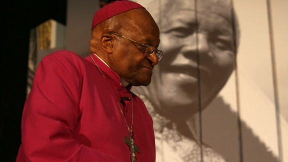 Archbishop Desmond Tutu attends an exhibition on Nelson Mandela in Cape Town, South Africa, in 2013.
