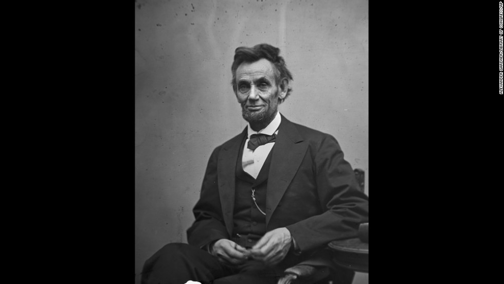 "President Abraham Lincoln holds his spectacles and a pencil in February 1865. A year earlier, a pamphlet called ""Miscegenation"" accused Lincoln of supporting interracial sex to create an ""American race."" It was a hoax meant to cost him his re-election. It didn't work, but the rumor never truly died."