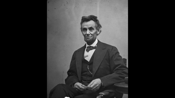 """President Abraham Lincoln holds his spectacles and a pencil in February 1865. A year earlier, a pamphlet called """"Miscegenation"""" accused Lincoln of supporting interracial sex to create an """"American race."""" It was a hoax meant to cost him his re-election. It didn't work, but the rumor never truly died."""