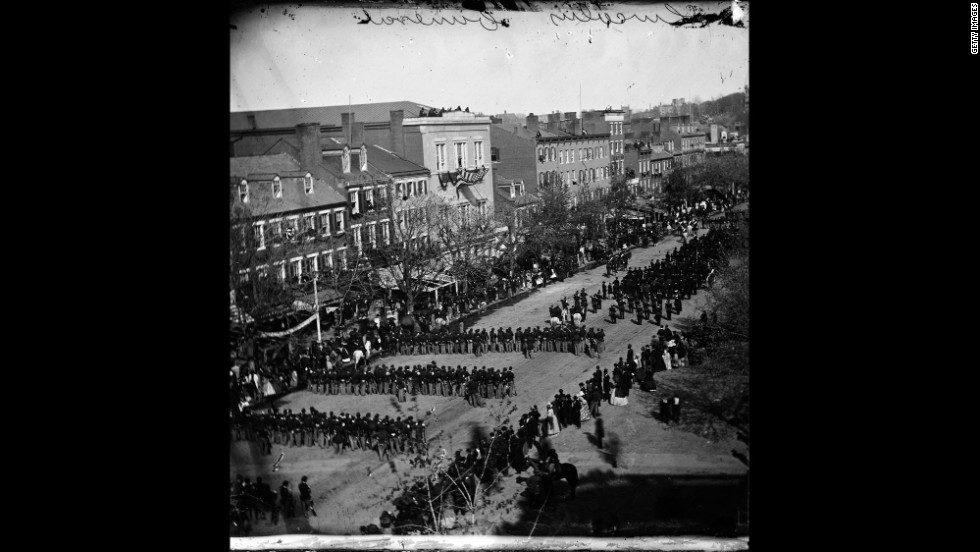 After his assassination, Abraham Lincoln's funeral procession moves down Pennsylvania Avenue in  Washington on April 19, 1865. His body was taken by funeral train to be buried in his hometown of Springfield, Illinois.