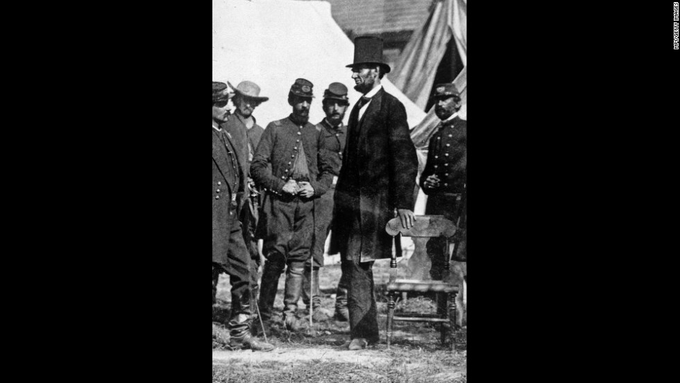 "President Lincoln stands with Gen. George McClellan (facing Lincoln) at the Antietam battlefield in Maryland in 1862, during the Civil War.  The anonymous authors of the ""Miscegenation"" pamphlet hoped to add to Lincoln's dimming popularity as the bloody war seemed to drag on forever."