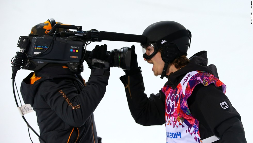 Podladtchikov, born in Russia but competing for Switzerland, shares his happiness up close with a TV camera.