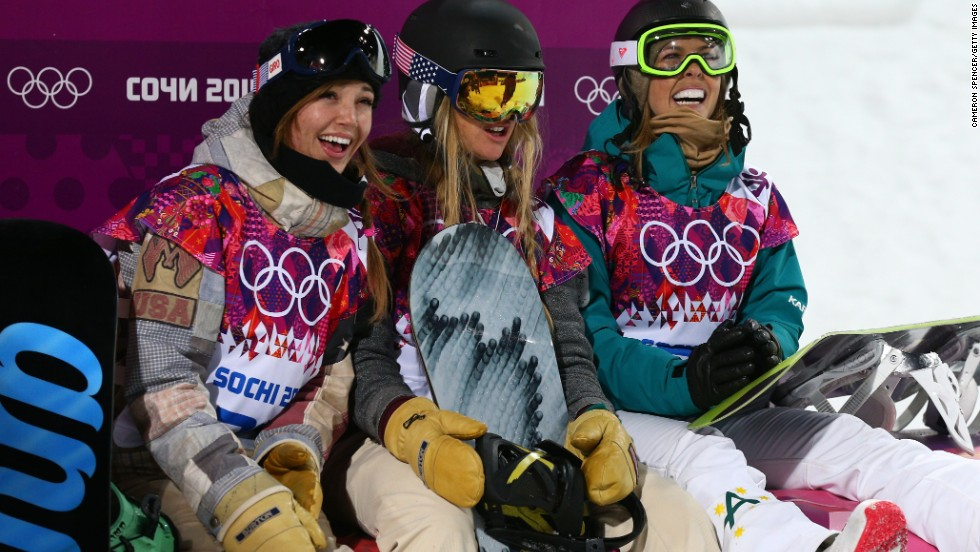American snowboarders Kaitlyn Farrington and Hannah Teter, along with Australia's Torah Bright, smile as they wait for the final results in their halfpipe competition.