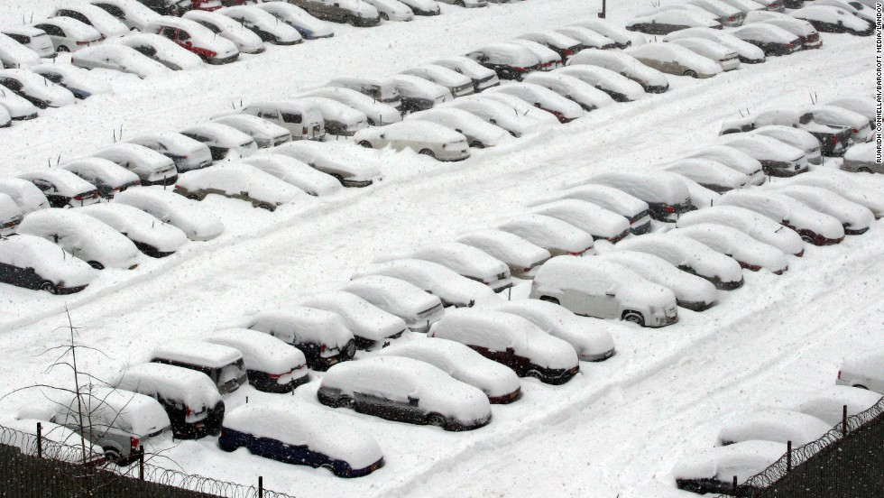 Snow covers cars in Brooklyn on February 13.