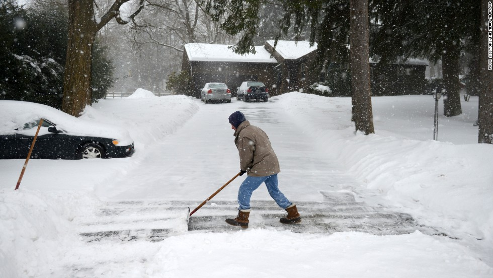 Don Hammond of Newtown, Connecticut, shovels his driveway as snow continues to fall February 13.