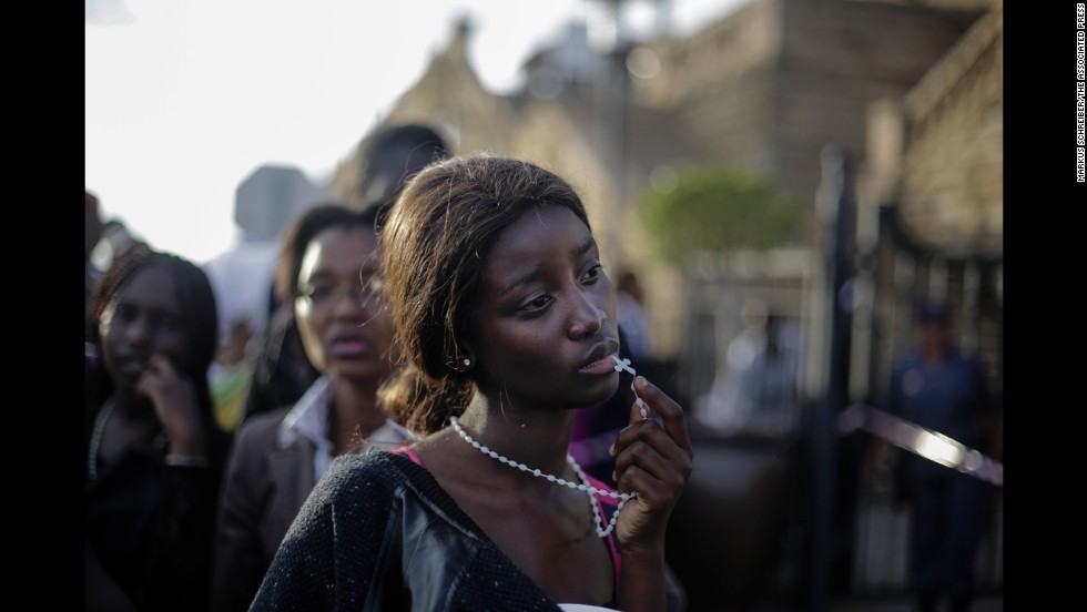 <strong>1st Prize People -- Observed Portraits Single: </strong>A woman is disappointed after access to see former South Africa President Nelson Mandela was closed on the third and final day of his casket lying in state outside Union Buildings in Pretoria, South Africa.