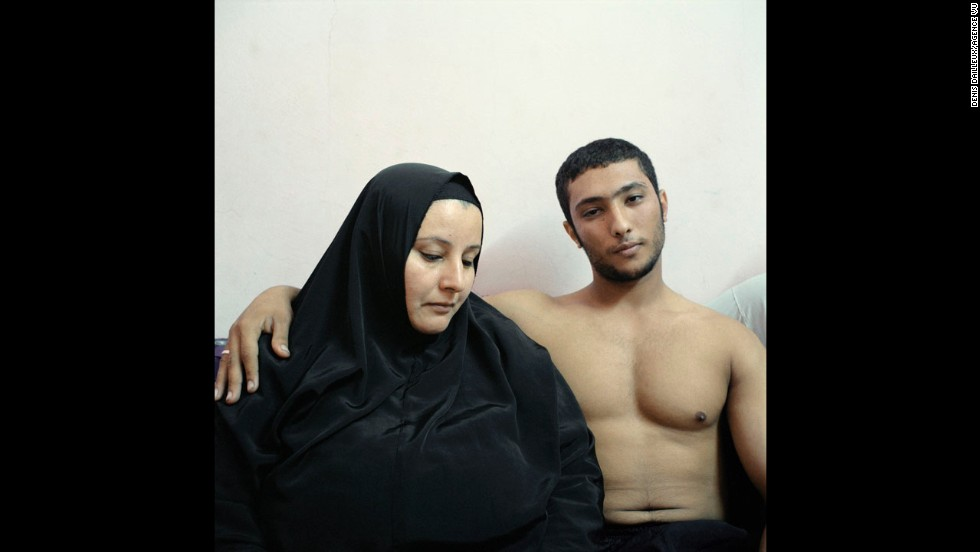 <strong>2nd Prize People -- Staged Portraits Stories:</strong> Ali, a young Egyptian bodybuilder, poses with his mother.
