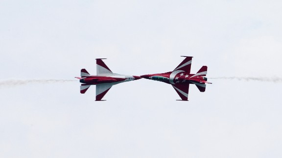 The Republic of Singapore Air Force's Black Knights perform maneuvers in F-16C Fighting Falcon jets during an aerobatic flying display on February 11.