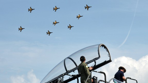 Onlookers watch as the South Korea Air Force aerobatic team performs on February 13.