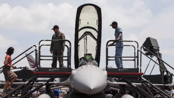 People are shown a Lockheed Martin Corp. F-16D Fighting Falcon aircraft on Thursday, February 13.
