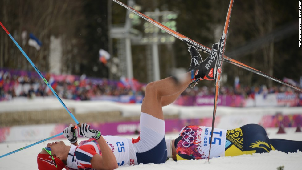 Norwegian cross-country skier Chris Andre Jespersen lies on the snow after crossing the finish line in the men's 15-kilometer classic on February 14.
