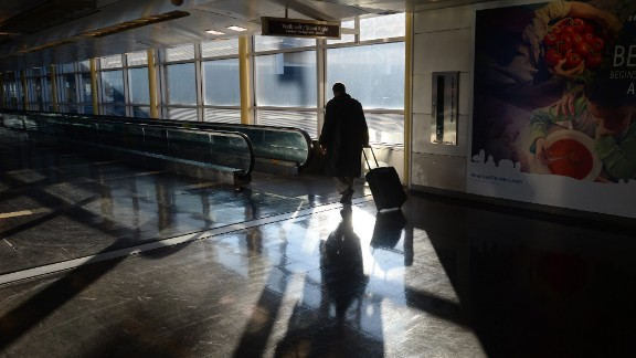 A traveler walks through Ronald Reagan National Airport in Arlington, Virginia, on February 14. Numerous flights were canceled and delayed this week as a result of the snowstorm that pounded a huge section of the country.