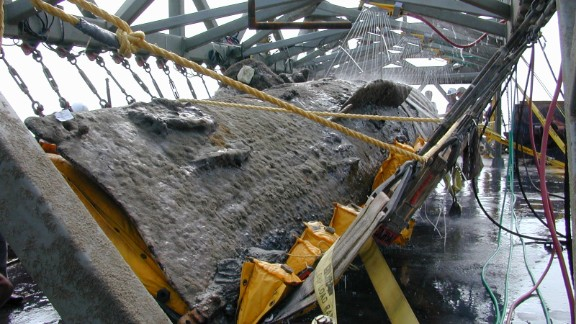 """Conservators later began a new process -- filling the tank that holds the Hunley with chemicals that helped strip away what is called """"concretion"""": organic material that has coated the hull and interior."""