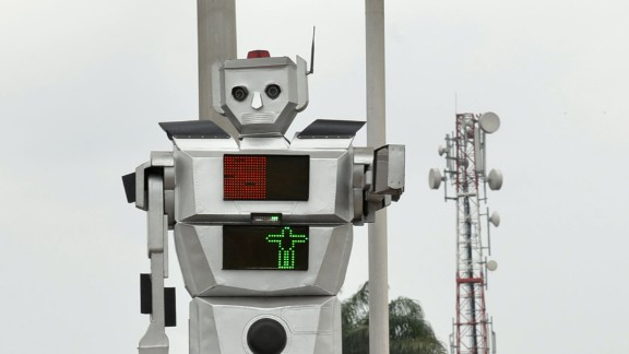 The humanoids are also programmed to speak, telling pedestrians when they can cross the road or not.